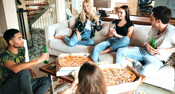 Co-Founder story - Groups of friends talking and eating pizza. Image Copyright - Unsplash.
